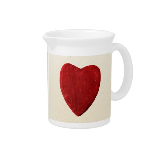 Finery background with heart beverage pitchers