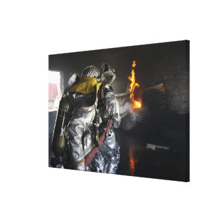 Firefighters extinguish a fire in a training ro canvas print