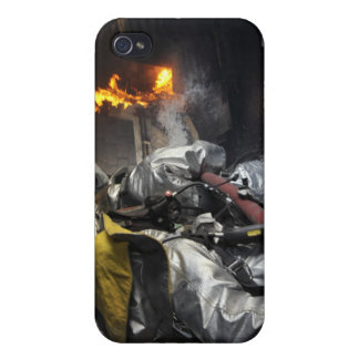 Firefighters extinguish a fire in a training ro iPhone 4 cover