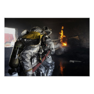 Firefighters extinguish a fire in a training ro poster