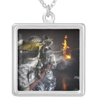 Firefighters extinguish a fire in a training ro silver plated necklace