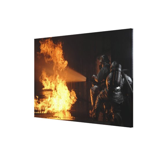 Firefighters extinguish a simulated battery fir canvas print