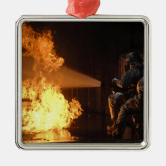 Firefighters extinguish a simulated battery fir christmas ornament