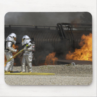 Firefighters neutralize a live fire mouse mat