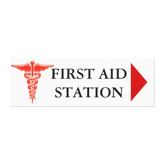 First aid direction sign stretched canvas print
