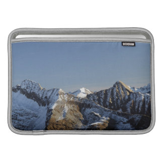 First snow on the mountains MacBook sleeve