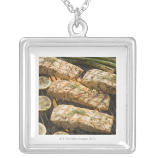 Fish and asparagus cooking on grill silver plated necklace