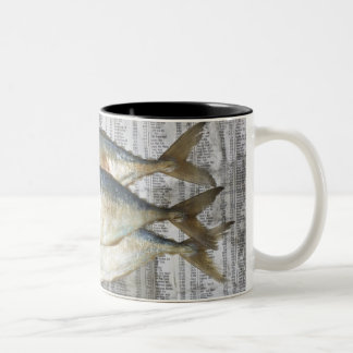 Fish on financial newspaper, elevated view Two-Tone coffee mug