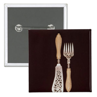 Fish-servers with carved ivory handles 15 cm square badge