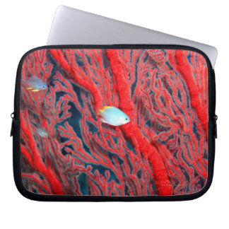 Fish swimming in coral laptop sleeve