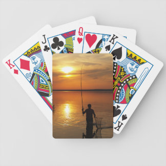 Fisherman catches fish by spinning bicycle playing cards