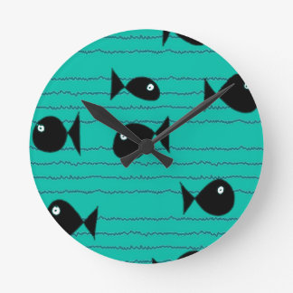Fishes and reeds round clock