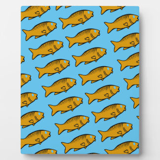 fishes swimming plaque