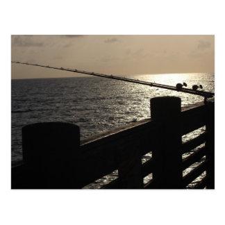 Fishing at sunset postcard