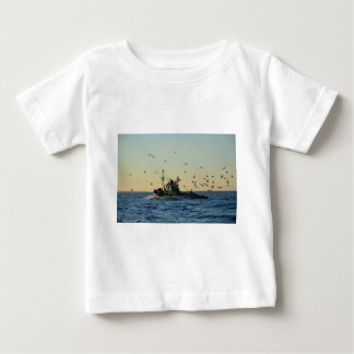 Fishing boat and a flock of gulls. baby T-Shirt