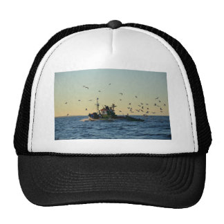 Fishing boat and a flock of gulls. cap