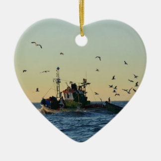 Fishing boat and a flock of gulls. ceramic heart decoration