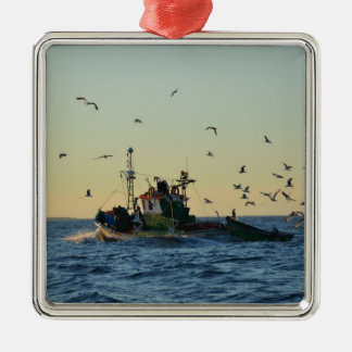 Fishing boat and a flock of gulls. Silver-Colored square decoration