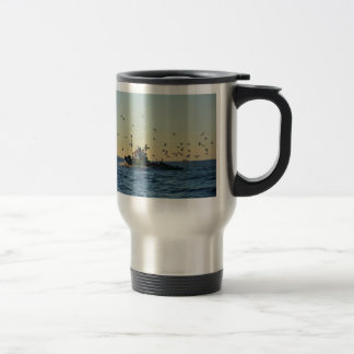 Fishing boat and a flock of gulls. travel mug