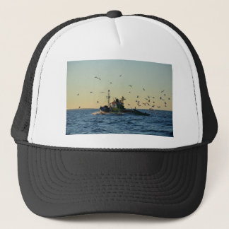 Fishing boat and a flock of gulls. trucker hat
