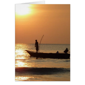 Fishing boat and sunset greeting card