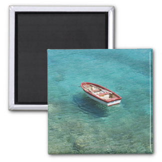 Fishing boat in clear, colorful water, Mani Square Magnet