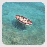 Fishing boat in clear, colourful water, Mani Square Sticker
