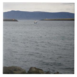 Fishing boat leaving harbour, Reykjavik, Iceland Tile