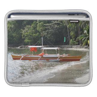Fishing boat on the beach iPad sleeve