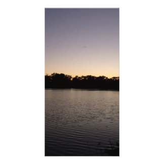 Fishing poles silhouette against the sun set photo greeting card