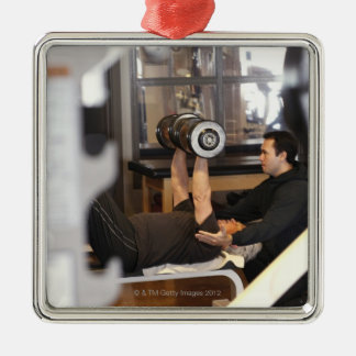 fitness coach works with 'senior' in gym Silver-Colored square decoration
