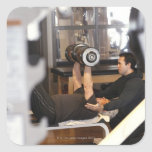 fitness coach works with 'senior' in gym square sticker