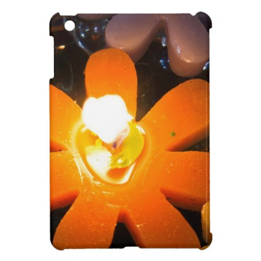 Flame from an orange floating candle iPad mini cover