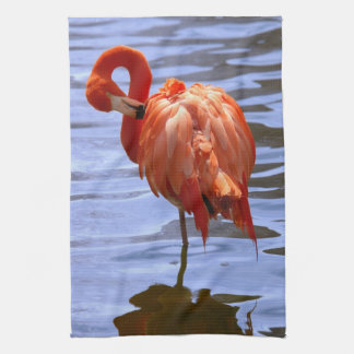 Flamingo on one leg in water tea towel