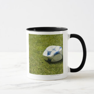 Flat soccer ball in grass, Germany Mug