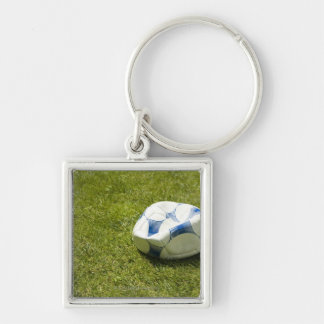 Flat soccer ball in grass, Germany Silver-Colored Square Key Ring