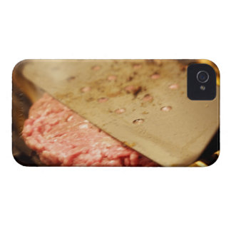 Flattening a Hamburger Patty with a Spatula on iPhone 4 Covers