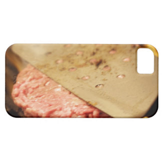 Flattening a Hamburger Patty with a Spatula on iPhone 5 Cover