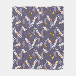 Fleece blanket with flying sleeping kitties