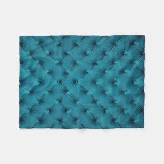 Fleece Blanket with teal capitone