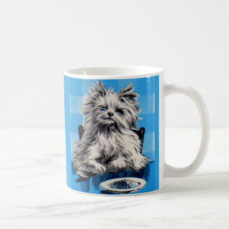 floofy dog eating at the table coffee mug