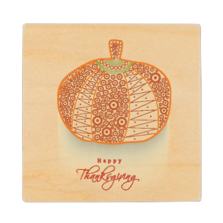 Floral Decorated Shiny Pumpkin On Abstract Wood Coaster