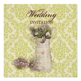 floral design in tin pitcher on green floral wallp invite