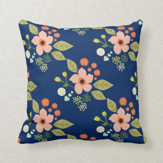 Floral patterned pillow with navy blue and peach