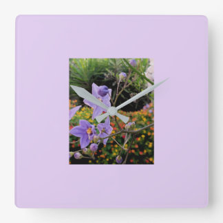 Floral wall clock in delicate mauve shades