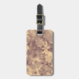 Flower and leaf camouflage pattern on beige bag tag