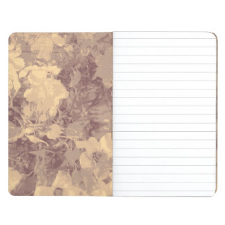 Flower and leaf camouflage pattern on beige journals