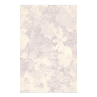 Flower and leaf camouflage pattern on beige stationery