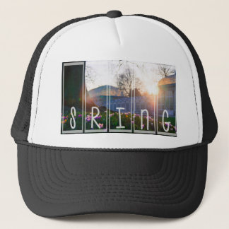 Flower blossom under the tree trucker hat