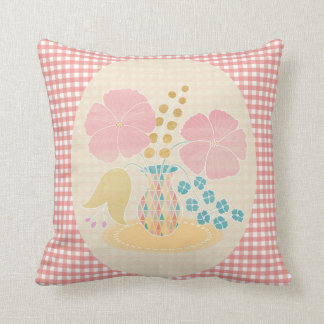 Flower in a vase on pink gingham cushion